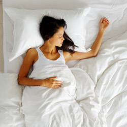 Woman Sleeping on Mattress